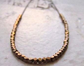 modern brass beaded necklace. helsinki