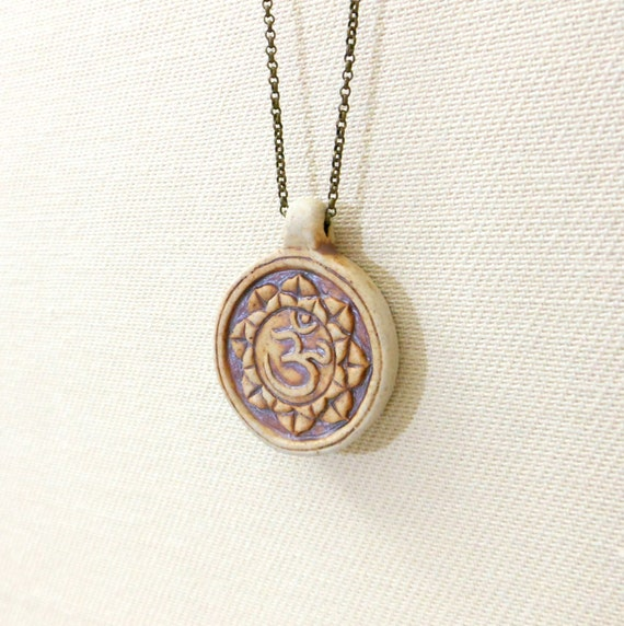 Lotus flower necklace with earthy ceramic ohm symbol pendant