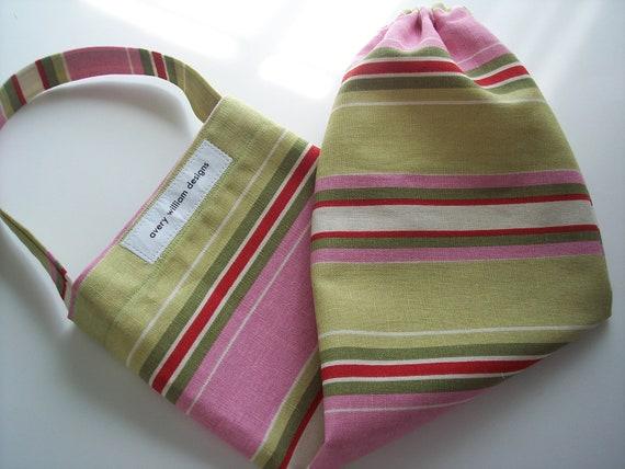 pink and green stripe plastic bag holder