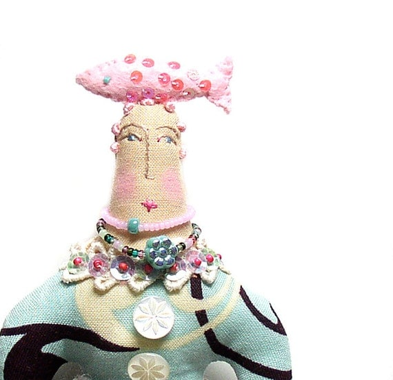 Textile art handmade cloth art doll with a felt fish on top of her head