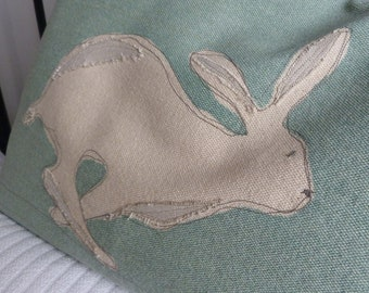 handprinted hare cushion cover with applique detailing