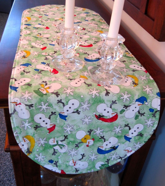 Winter Snowman Table Runner 36 Inch Reversible with white sparkle snowflakes on green snowflake table runner winter table runner