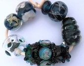 Teal and dark green hand made lampwork glass beads - odd lot of 7