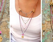 a Charming colorful One of a kind Believe Charm necklace