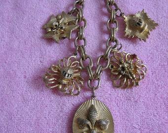 Vintage Coro Medieval Knights Charm Bracelet.  1950's.  Lion, Crown, Maltese cross, Fleur de lys.