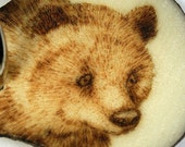 Bear 7 -- Burned on a tagua nut slice and made into a key chain (TN79)