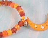 Orange Moon Charm Plastic Beaded Stretch Bracelet Medium with Jingle Bell