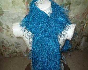Hand knitted Blue eyelash scarf, perfect accesorie for a cold day.