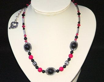 Black Swarovski crystal pearl and hot pink fossil necklace