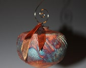 Hand-thrown Raku Ornament with Copper Flashing Glaze