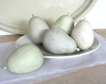 Five hand built earthenware pears. Natural, neutral, pale, light, rustic, elegant, ceramic, clay.