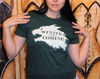 Winter Wolf. Women's fitted American Apparel fitted sizes small, medium, large, or extra large in FOREST GREEN.