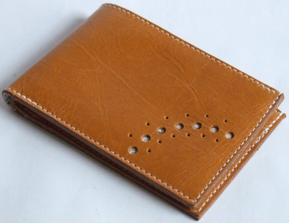 Tan leather card wallet with pale floral lining, two card pockets, notes pocket