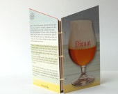 Mini notebook, coptic stitch notebook with pockets // recycled notebook from a Piraate Belgian ale box
