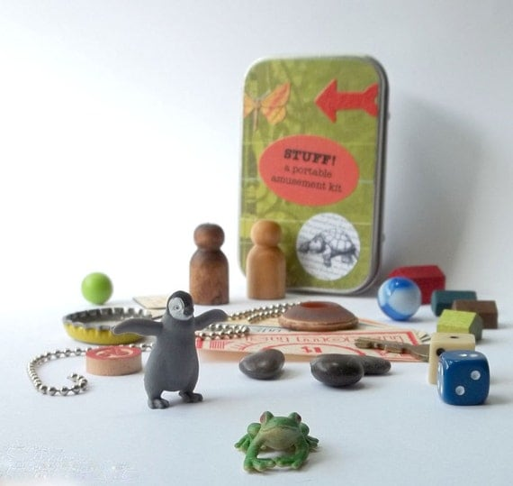 Small toys with tiny frog and penguin in a little tin box