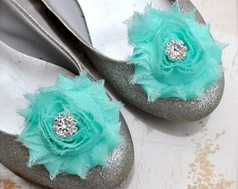 Chic blossom shoe clips with rhinestone centers. 71 colors available. New in seafoam green for weddings.