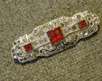 Vintage Art Deco brooch with paste stones and emerald cut ruby glass stones