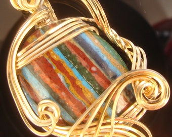 Rainbow Calsilica in gold filled wire setting