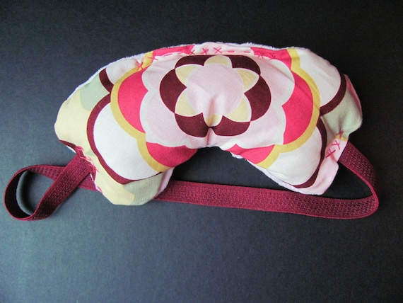 Pink Zen Sleep Mask, with Pink Dimpledot material with hearts on facial side, for sleeping, relaxing or recovering.