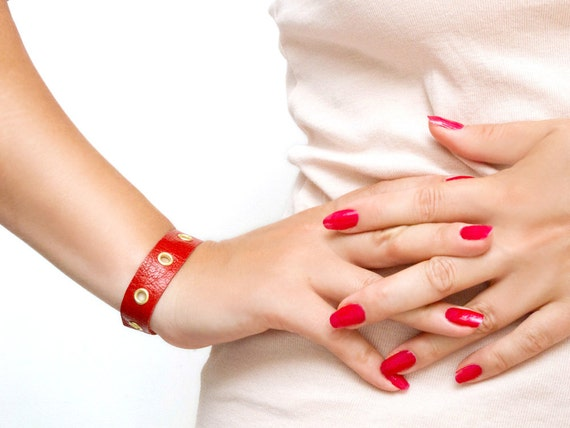 Red leather cuff bracelet with gold eyelets