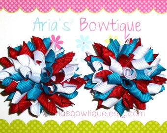 A Pair Of Turquoise, Red And White Mini Korker Hair Bows