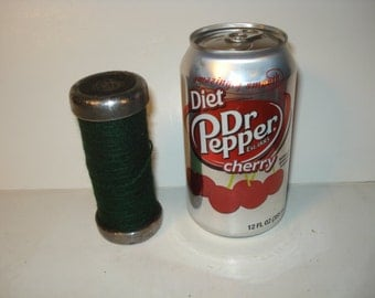 Vintage Colorful Industrial Spindle with Dark Green Thread