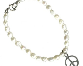 sterling silver peace sign freshwater pearl childrens bracelet