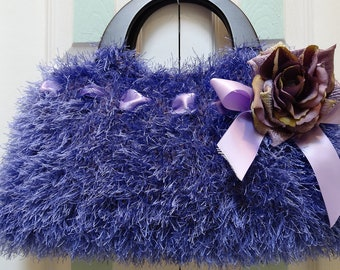KNIT PURPLE HANDBAG/Purse hand knitted in a  fur like yarn with  black wooden handles and a purple ,lavender rose