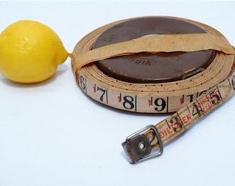 Vintage measuring tape with bag