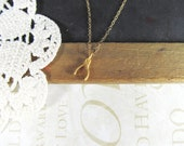 A dream is a WISH your heart makes petite wishbone necklace (gold)