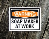 Soap Maker At Work Aluminum Sign