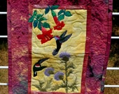 Quilted wall hanging appliqued hummingbirds and flowers