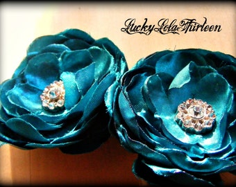 Two blue satin flowers with rhinestone embelished center hair clips