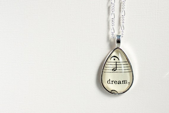 Silver teardrop pendant set with vintage sheet music under glass. Romantic gift for musician music lover