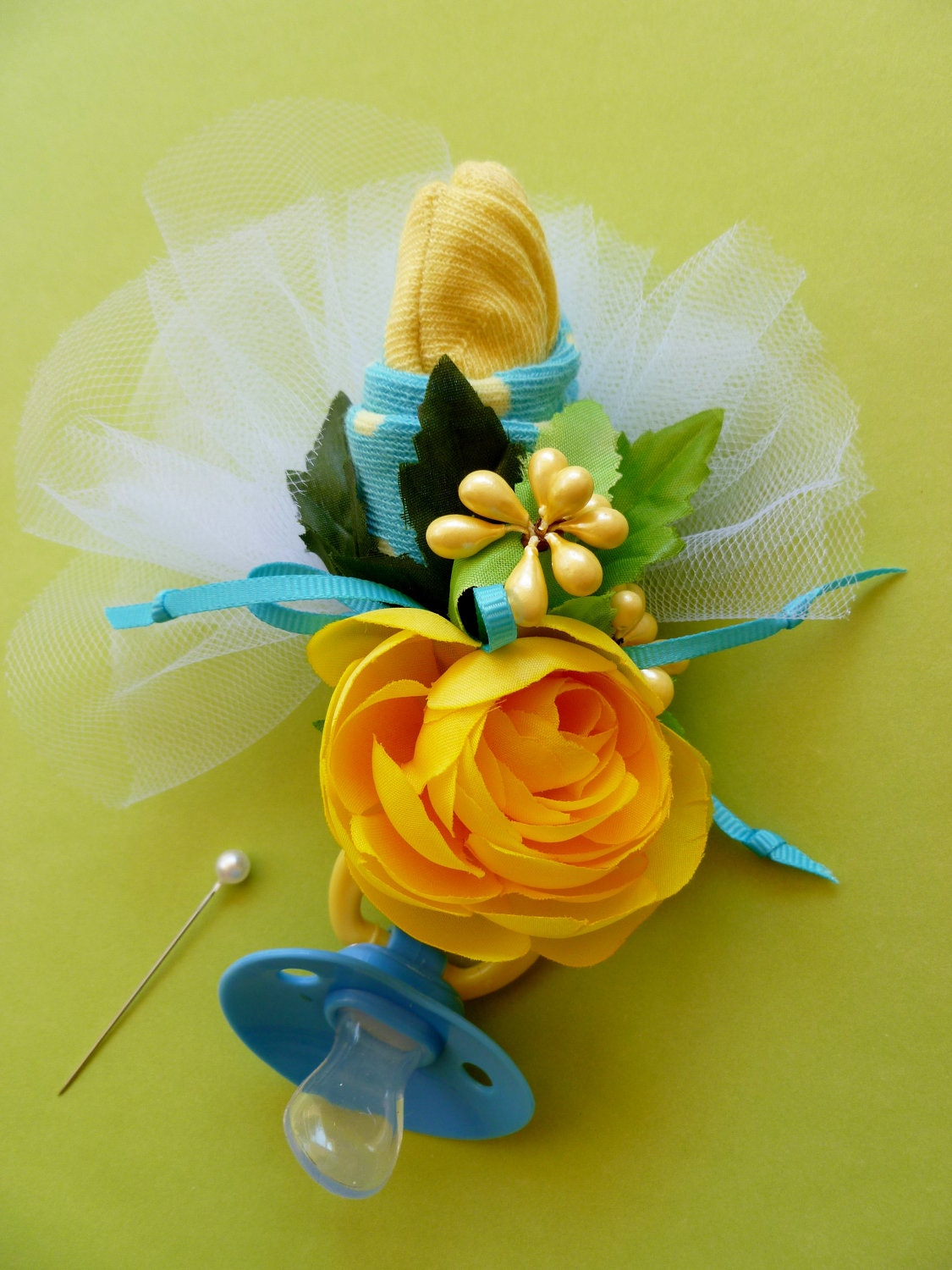 mom to be baby shower corsage with baby socks and pacifier in