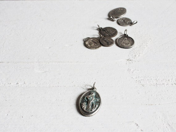 Seven French religious charms or medals
