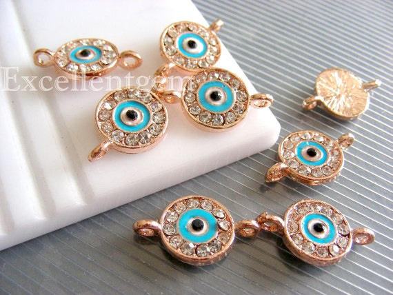 5pcs Rose gold tone with clear crystal rhinestone evil eye connector beads in sky blue color.