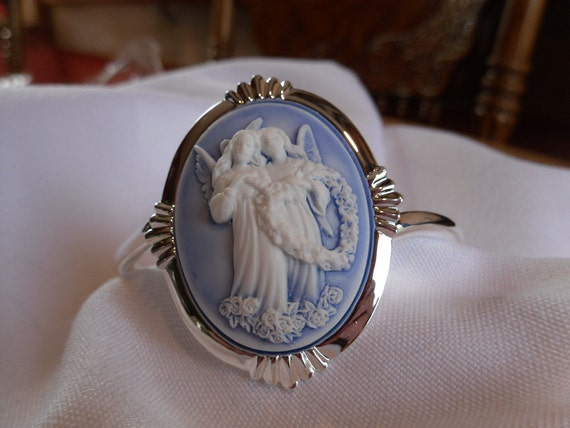 Angels Entwined in a Heart made of roses on a Blue Background Cameo Cuff Bracelet