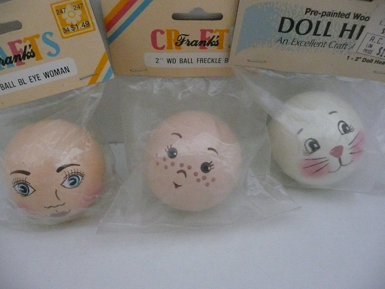 Three 2 Inch Painted Wooden Doll Heads