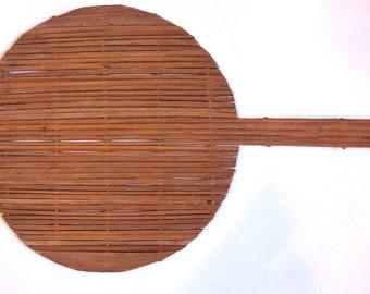 vintage wooden paddle for serving