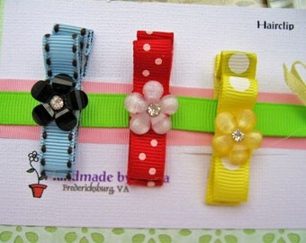 Tuxedo Bow Hair Clippies with Flower button in Red Sunshine Yellow and Blue