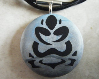 Floating in the sky buddha-lotus hand carved  on a polymer clay grey pearl and blue pearl background. Pendant comes with a FREE 3mm necklace