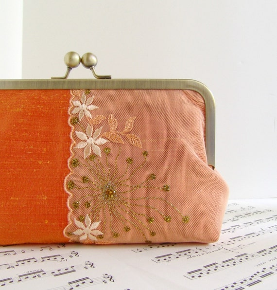 Silk tangerine orange clutch in frame with lace flower overlay