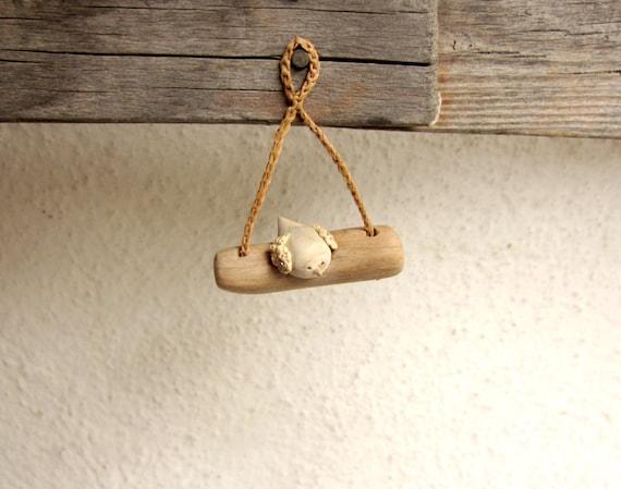 Miniature bird on a twig, native wall art