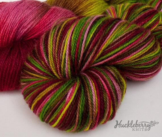 Handpainted sock yarn:  WINESAP on Blue-Faced Leicester/nylon fingering, 4 oz