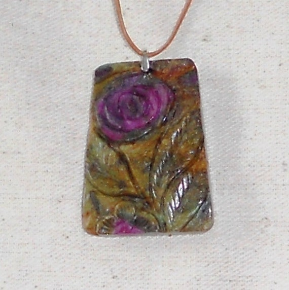 Carved rose flower ruby in zoisite pendant July birth stone on an adjustable leather cord packaged in a gift bag J542