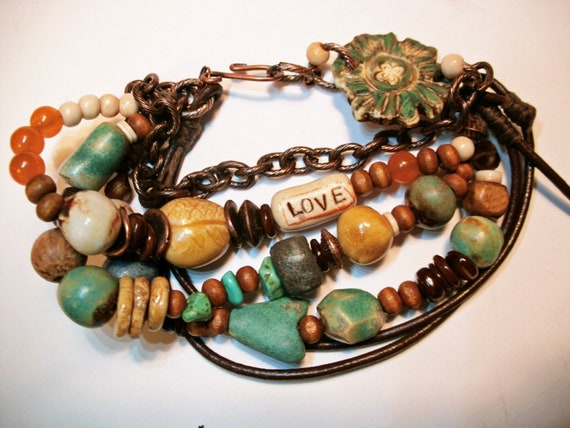 Multi Strand Bracelet...leaf bead..leather ceramic stoneware beads..amber blue aqua brown orange