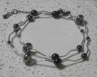 Gunmetal Grey Modern Elegance Necklace - Gunmetal Beads And Silver Swirly Tubes