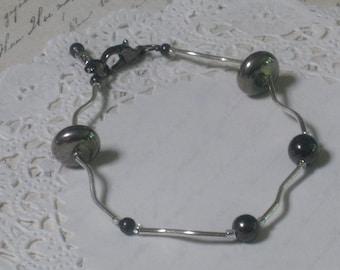 Gunmetal Grey Modern Elegance Bracelet - Gunmetal Beads And Silver Swirly Tubes