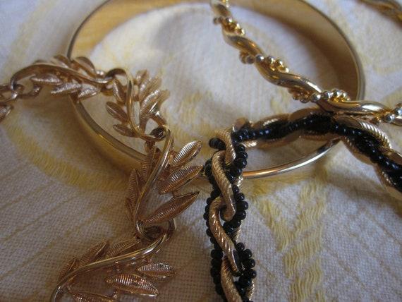 Lot of 4 Vintage Gold Tone Metal Bangle & Chain Bracelets MONET TRIFARI NAPIER